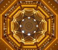 Dome roof at Imperial Palace. The goldendome roof of the Abu Dhabi Imperial Palace Hotel showing patterns of stars Royalty Free Stock Images