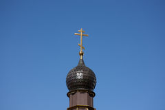 Dome of Russian orthodox church with cross against blue sky. Dome of Russian orthodox church with cross against sky Royalty Free Stock Images