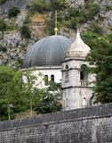 The dome of Saint Nicholas church rises above the wall of the medieval fortress  in the Old Town of Kotor, Montenegro. The dome of Saint Nicholas church rises Stock Photography
