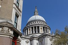 Dome of Saint Paul Cathedral through the houses surrounding. In London city center Stock Photography