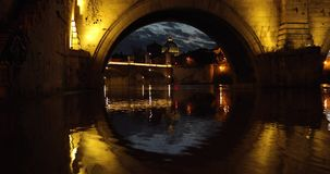 The dome of Saint Peter`s Basilica in Vatican. View through the arch of bridge, evening time stock footage