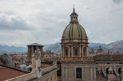 Dome of San Giuseppe dei Teatini church. Palermo skyline over roofs of historic buildings with the mountains in the background. I royalty free stock photo