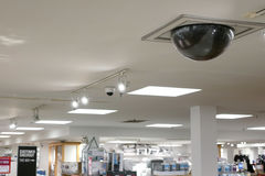 Dome security camera on top of ceiling Royalty Free Stock Images