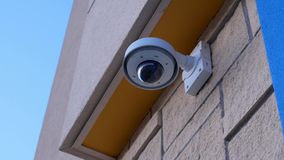 Dome security camera on top of ceiling outside Walmart store