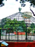 Dome shaped cage in a park stock photo