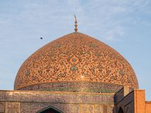 The dome of Sheik Lotfollah Mosque in Isfahan, Iran, during sunset. stock images