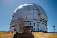 Dome of special astrophysical observatory on blue sky background at sunny day.  stock photo