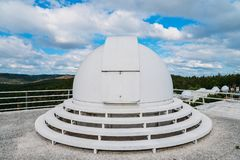 Dome of special astrophysical observatory on blue sky background at sunny day. Dome of special astrophysical observatory on blue sky background at sunny day stock photos