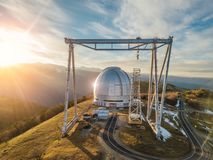 Dome of special astrophysical observatory in the evening. Aerial view.  stock image