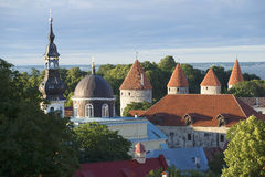 The dome and spire of the Church of Transfiguration of Christ and the medieval towers. Old Tallinn Royalty Free Stock Photography