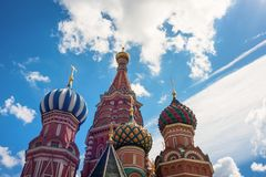 Dome of St. Basil`s Cathedral on the background of blue sky and clouds Royalty Free Stock Photos