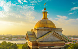 Dome of St Isaac Cathedral and beautiful sunset sky. Aerial view over St. Petersburg, Russia, from the dome of St. Isaac`s Cathedral see the square with tourist Stock Images