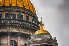 The dome of St. Isaac`s Cathedral. Holy temple in the city cente. The dome of St. Isaac`s Cathedral. Holy temple. Russia, Saint-Petersburg Royalty Free Stock Images