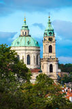 Dome of St Nicholas Church Cathedral surrounded by orange roof. Tops of Mala Strana, Prague, Czech Republic stock photo