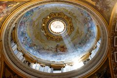 Dome of St. Peter`s Basilica with sunlight through the windows stock image