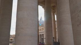 The dome of St. Peter`s Basilica in the Vatican. View of the dome through the columns stock video