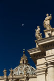 Dome of St Peters Basilica and Carvings on top of Colonnades, Va Stock Photos