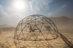 Dome structure in a dusty sand storm with information sign Royalty Free Stock Photos
