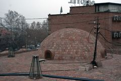 Dome of sulfur baths in old town Tbilisi,Georgia. Architecture of the Old town of Tbilisi, in Abanotubani district. The great dome of sulfur baths Stock Images