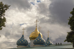 Dome of a temple against a cloudy sky background. Temple of St. Sergius of Radonezh, the dome of the Orthodox cathedral against the background of clouds Stock Photography