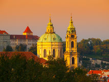 Dome and tower of St. Nicholas Church in Prague. Illuminated dome and tower of St. Nicholas Church in Lesser Town of Prague - capital city of Czech republic stock photo