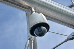Dome type CCTV camera. Close up of Dome type CCTV camera against the blue sky Royalty Free Stock Images