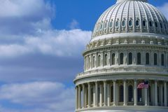 Dome of US Capitol Building. In Washington DC with waving national flag Royalty Free Stock Photo