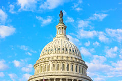 The dome of US Capitol building in Washington DC. Statue of Freedom at the top of US Capitol under a blue sky with clouds Stock Photography