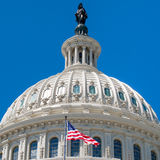 Dome of the Us Capitol at Washington with a United States Flag Stock Photos