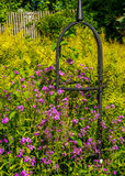 Domed Arbor On a Green with Purple Flowers Royalty Free Stock Images