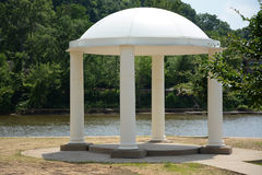 Domed gazebo. In a park by the river Royalty Free Stock Photo