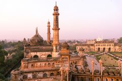 Domed roof and towers of Asfi mosque shot at sunset. From the rooftop of bara imambara in lucknow uttar pradesh india. This marvel of mughal architecture is a Stock Photography