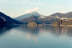 Domegio di Cadore, Italy Beautiful lake in the mountains at sunrise.  royalty free stock photo