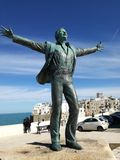Domenico Modugno` statue in Polignano a Mare stock photography