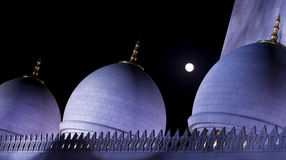 Domes. Night shot of Shaikh Zayed Grand Mosque with a moon light Royalty Free Stock Photo