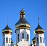 Domes of the ancient Russian church Stock Photos