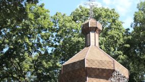The domes of an ancient wooden Orthodox church. Cross at the top. Ternopil Ukraine stock video footage