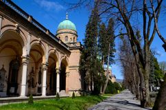 Domes arches walkway and graves at Mirogoj Cemetery and Park Zagreb Croatia. Zagreb, Croatia - March 30, 2015: A section of the Mirogoj Park and Cemetery in Stock Photography