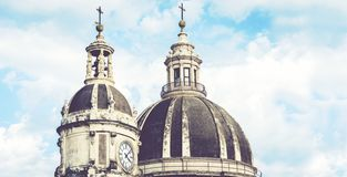 Domes of the Cathedral dedicated to Saint Agatha. The view of the city of Catania, Sicily, Italy royalty free stock image