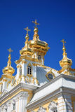 Domes of church. Of Petrodvorets on a background of the dark blue sky Royalty Free Stock Photography