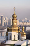 Domes of church in snow in Kiev Pechersk Lavra stock photography