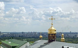 Domes in the clouds. Domes of Kiev-Pechersk Lavra in the clouds Stock Photo