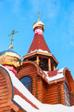 Domes with crosses on wooden orthodox church Stock Images