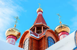 Domes with crosses on wooden orthodox church Royalty Free Stock Photo