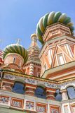 Domes of the functioning St. Basil`s Cathedral. The Intercession Cathedral St. Basil`s Cathedral, the uniquely beautiful domes of the functioning medieval church stock photo