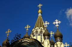 The domes and Golden crosses on the background of blue sky on the Church of the Resurrection in Sokolniki, Moscow, Russia. Horizontal view Royalty Free Stock Image
