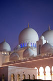 Domes of Grand mosque after the sunset. Islamic architecture in grand mosque Abu Dhabi,United Arab Emirates Stock Photos