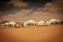 Domes hotel in desert. Wadi Rum Desert, Jordan. view of a resort offering domes homes inspired by the movie Mars. Some still under construction royalty free stock image