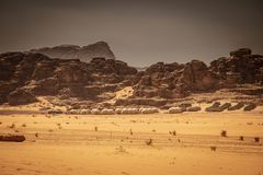 Domes hotel in wadi rum. Wadi Rum Desert, Jordan. Resort hotel with Bedouin tents and luxury domes inspired by the Mars movie. Rocky mountains in the background royalty free stock image