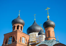 Domes of the Old Belief church against the blue sky. Russian Old Belief Church of the Intercession of the Most Holy Mother of God Royalty Free Stock Photos